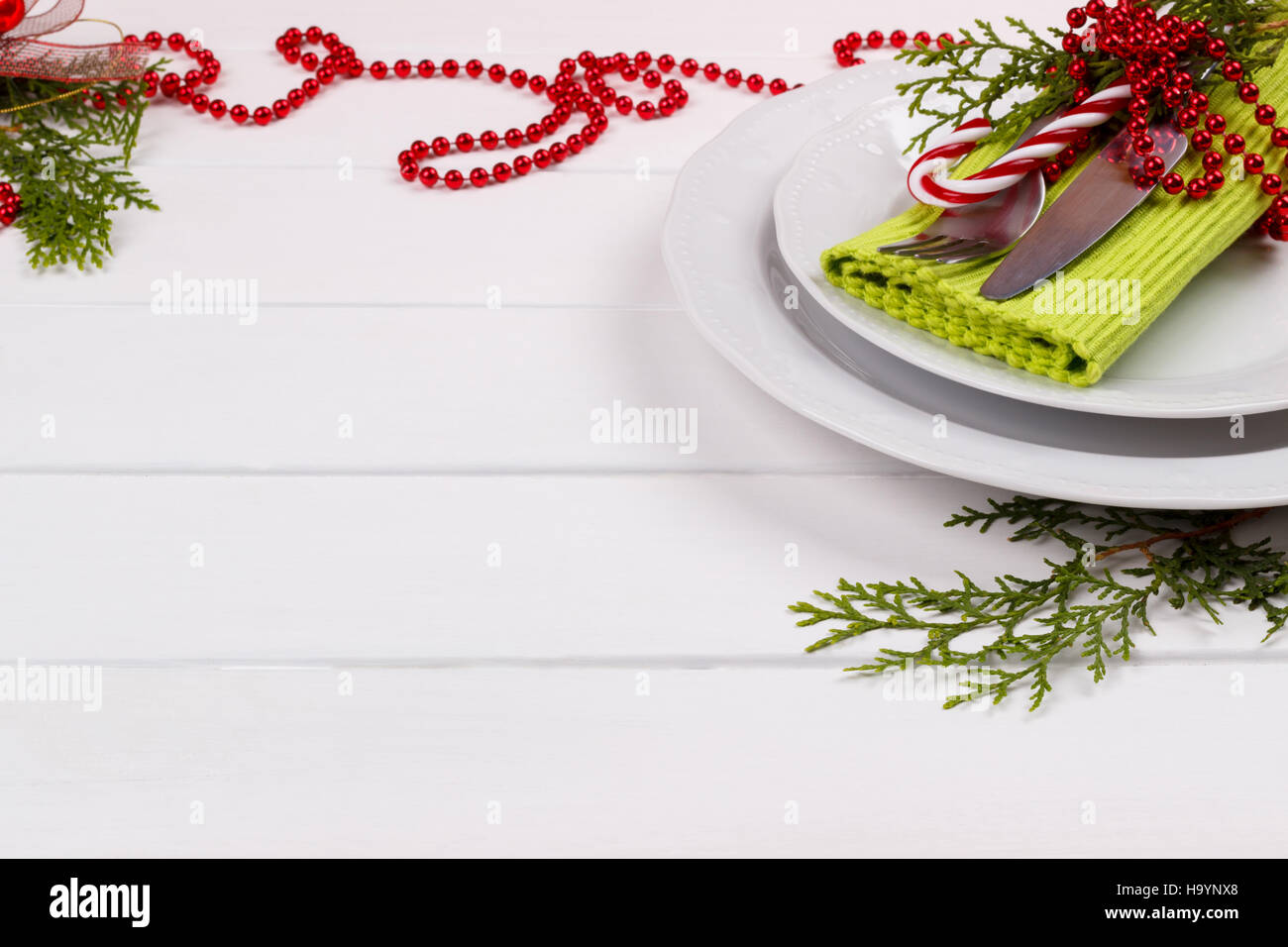 Christmas table setting on white wooden tableristmas card christmas table setting on white wooden tableristmas card template pronofoot35fo Image collections