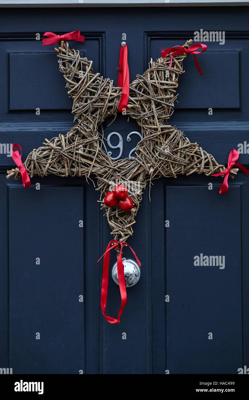 Star christmas wreath on dark gray front door stock photo royalty star christmas wreath on dark gray front door rubansaba