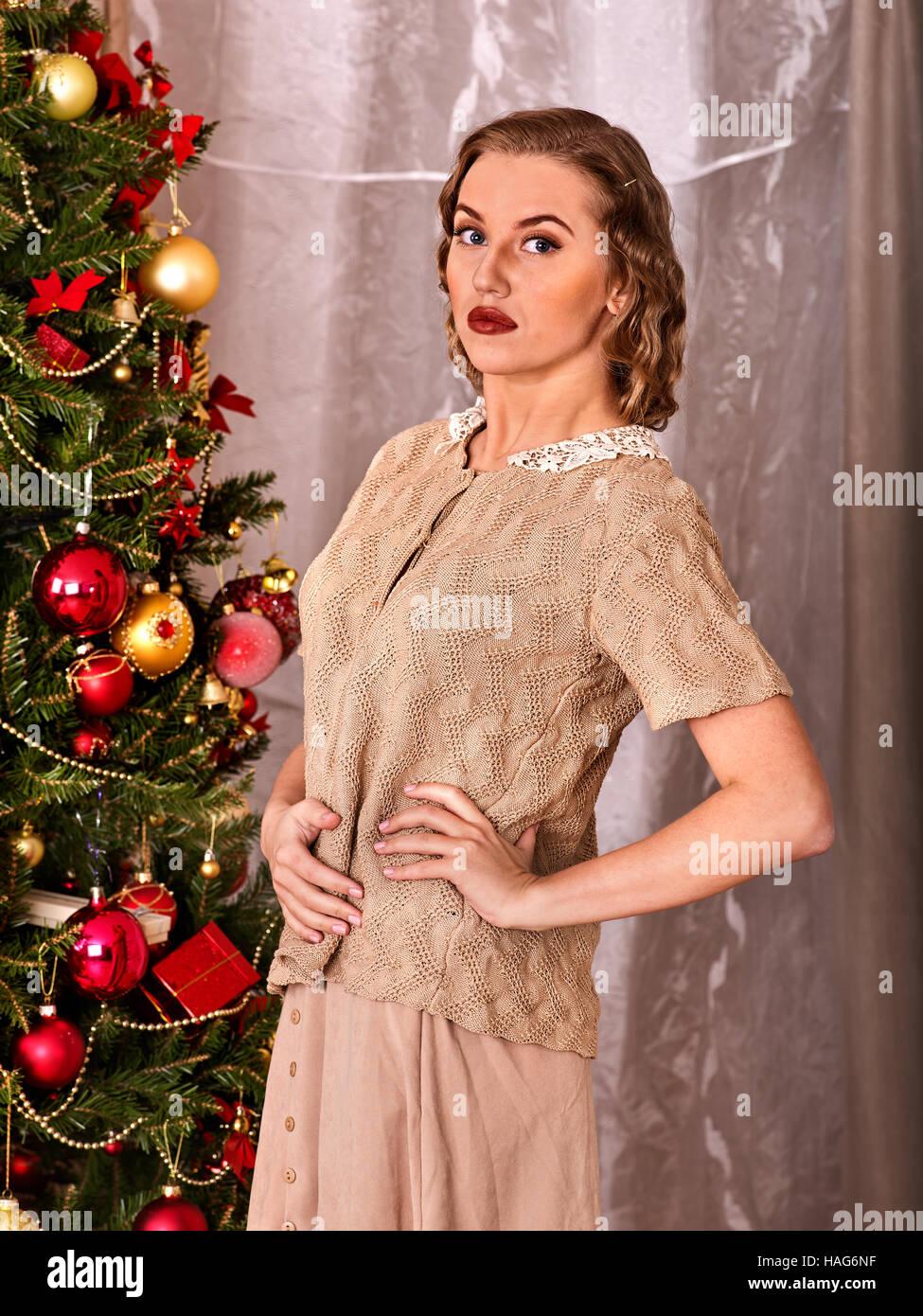 Woman dressing Christmas tree. Black and white Stock Photo ...