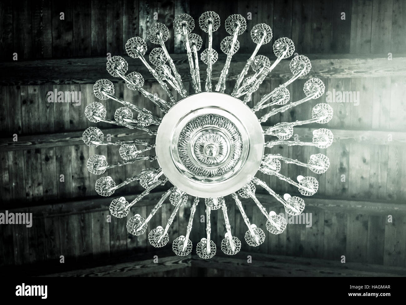 Ornate chandelier hanging of a beamed ceiling stock photo royalty ornate chandelier hanging of a beamed ceiling aloadofball Choice Image