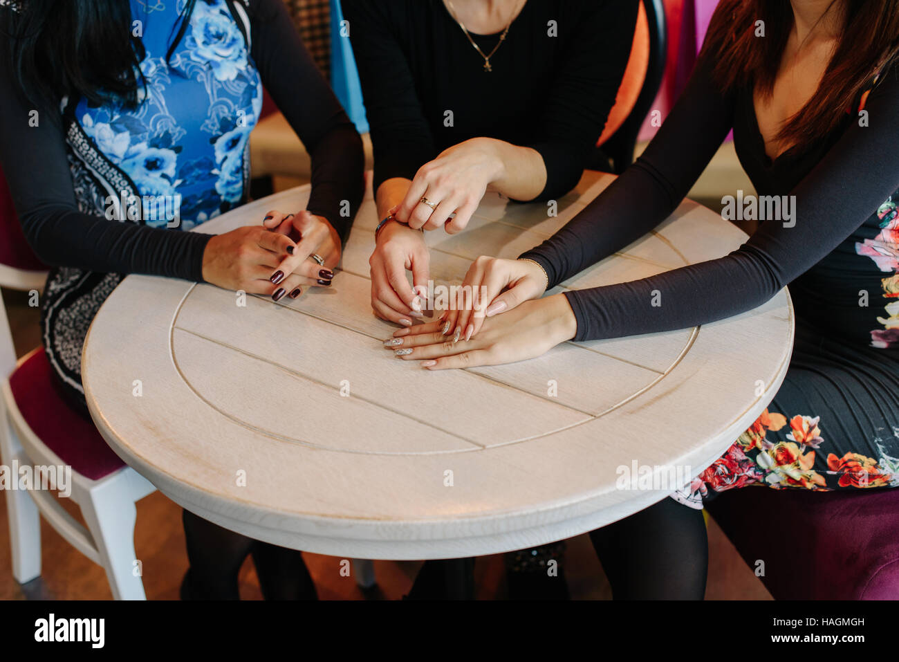 Close up photo of women hands. Three girls with beautiful hands ...