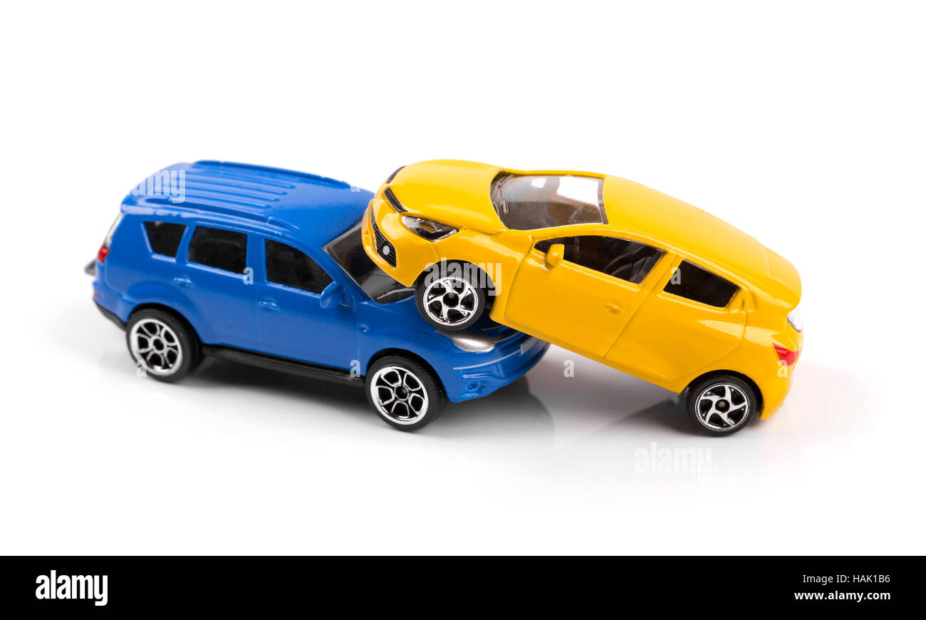 car accident concept two toy cars isolated on white stock. Black Bedroom Furniture Sets. Home Design Ideas
