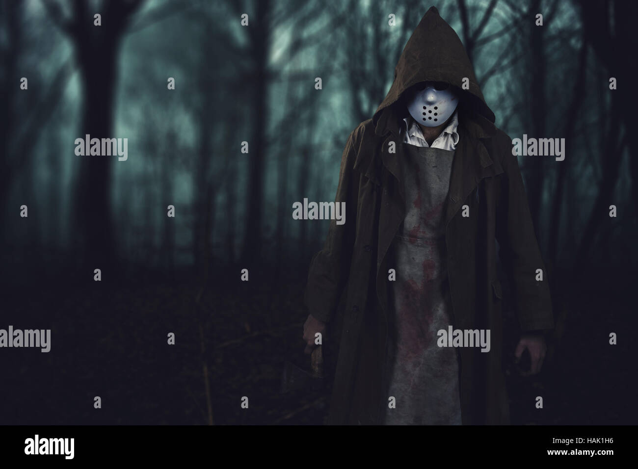 halloween background bloody serial killer with ax in the