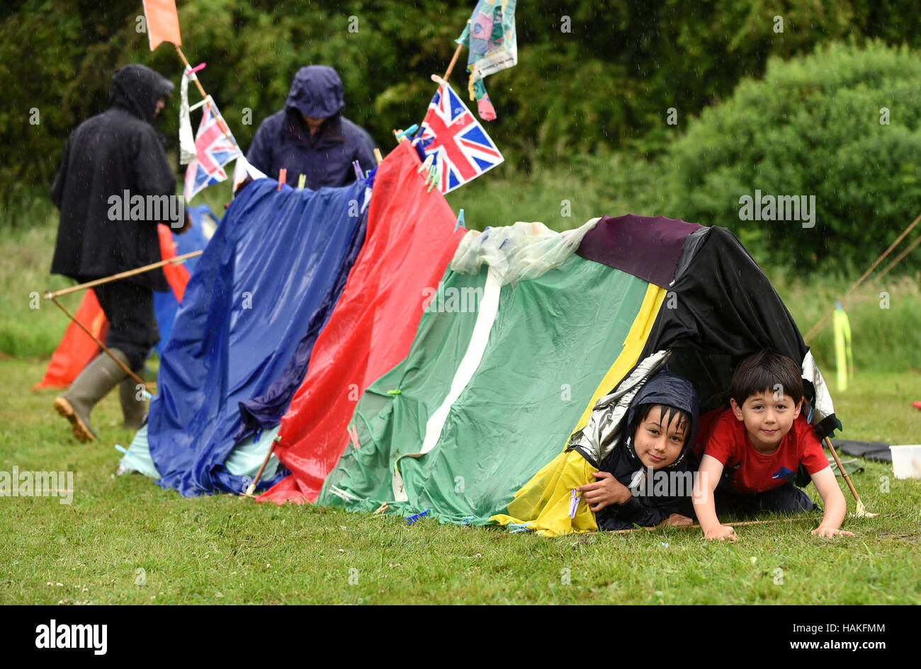 Children c&ing in home made tent at a wet rainy summer fete Uk  sc 1 st  Alamy & Children camping in home made tent at a wet rainy summer fete Uk ...