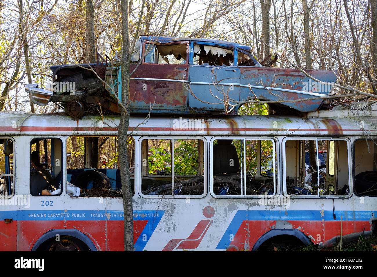 an old city bus is abandoned in a junkyard in frankfort indiana