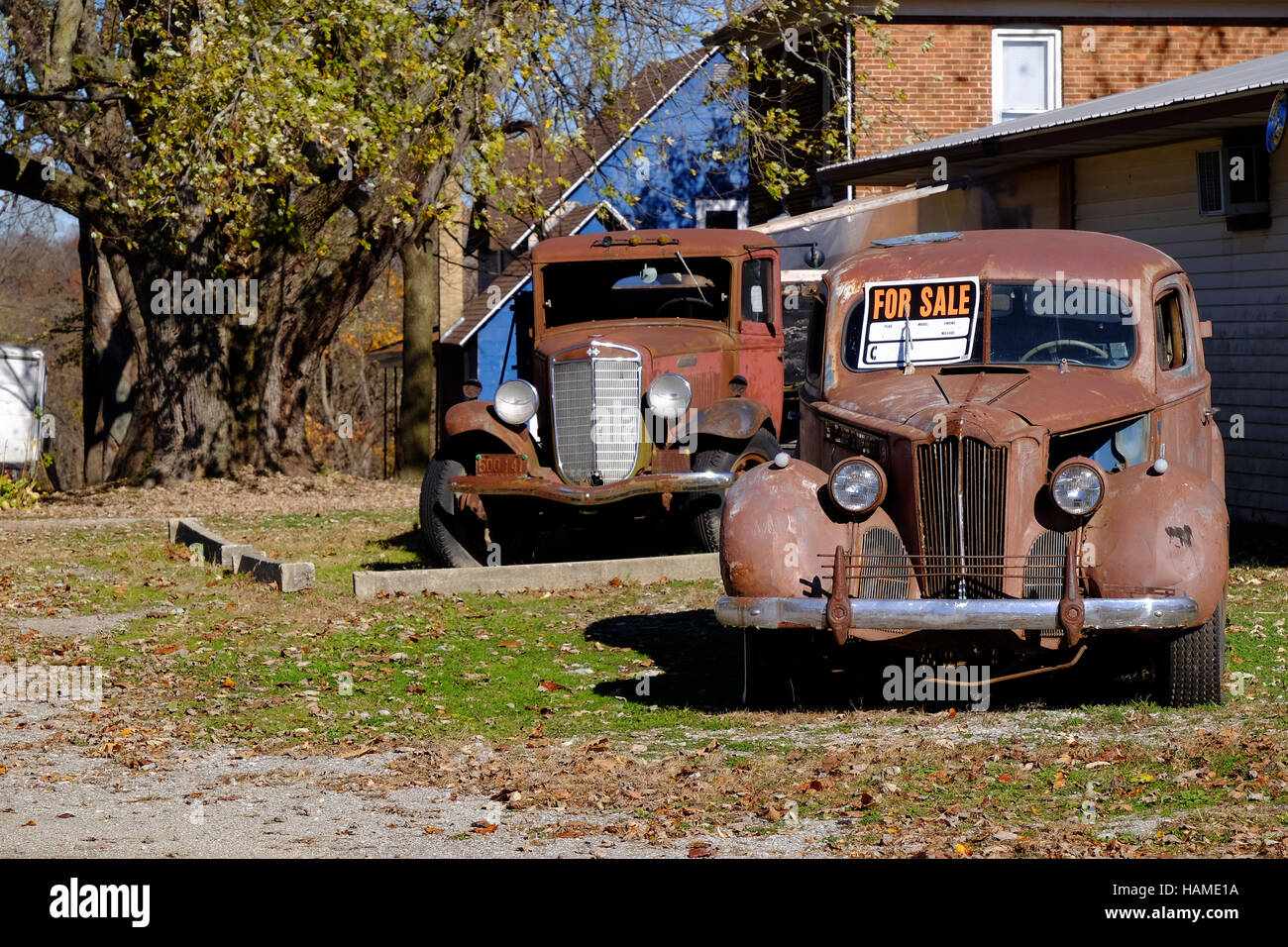 Two old cars for sale on the side of the road Stock Photo ...