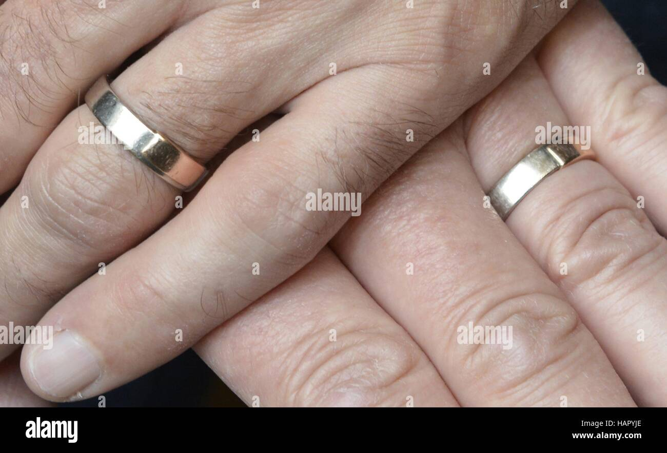 two gay men hold their hands with wedding rings april 14 2016 usage worldwide - Gay Mens Wedding Rings