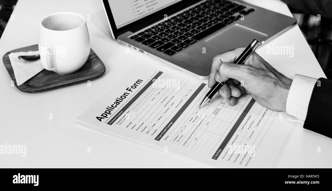 business man filling out application form concept stock photo business man filling out application form concept