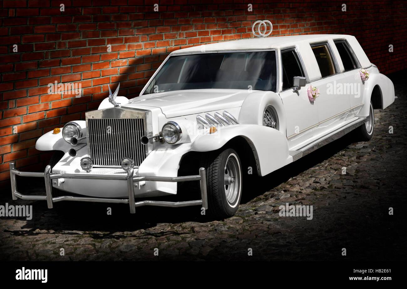 Classic American white Excalibur limousine, luxury wedding car ...