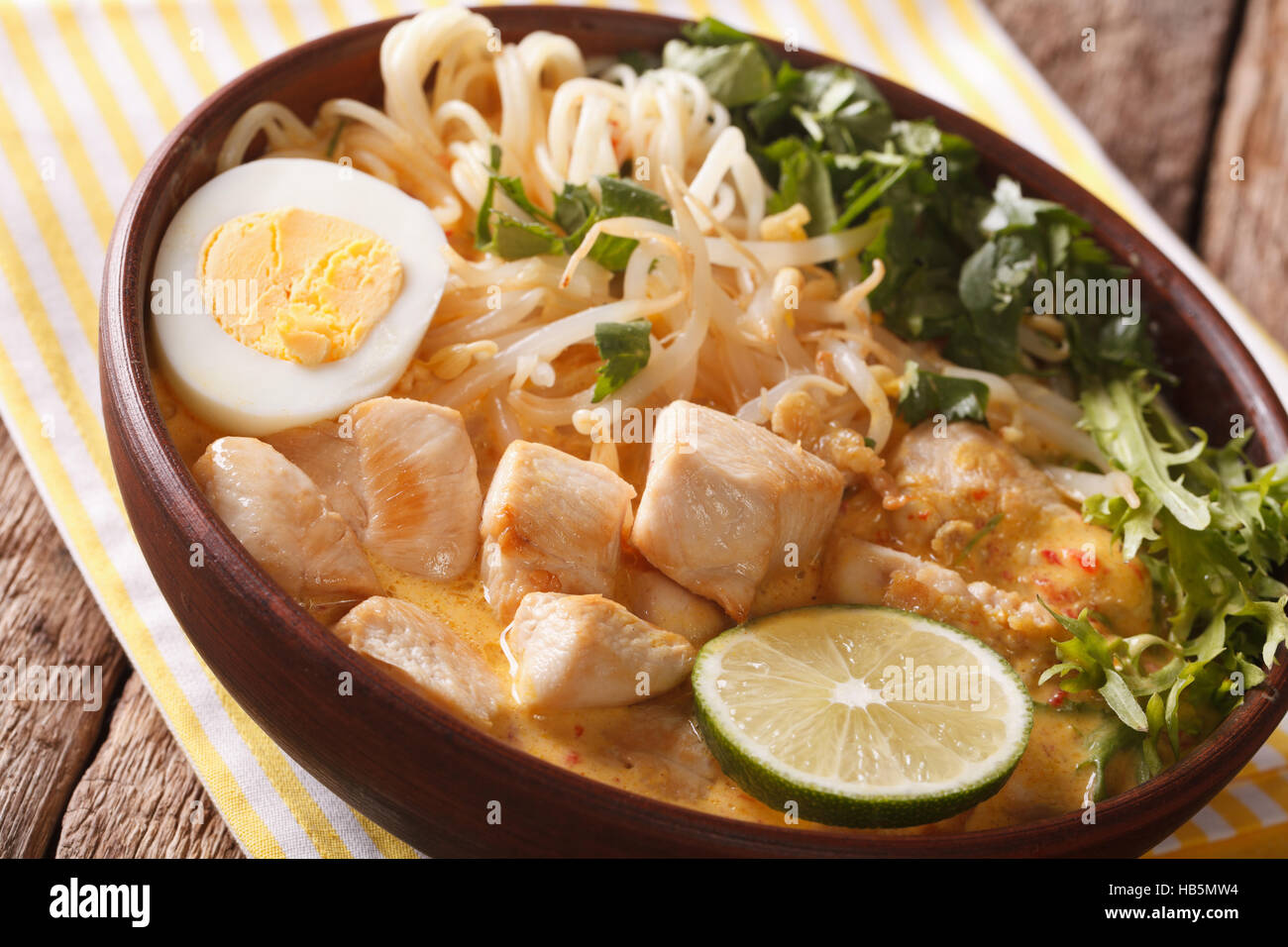 Asian Laksa Thick Soup With Chicken Egg Rice Noodles Bean Sprouts And Coriander
