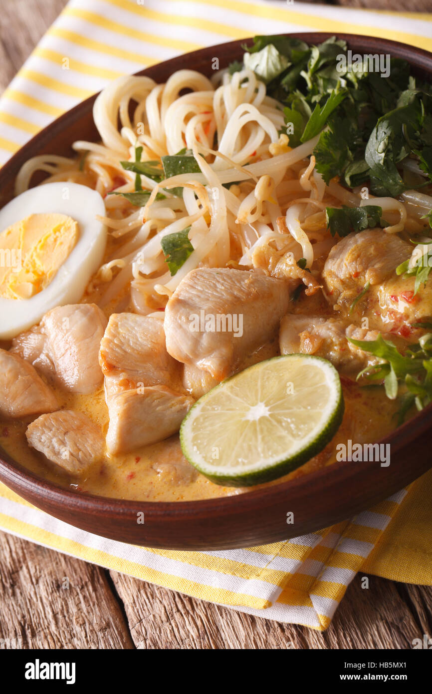 Laksa Soup With Chicken Egg Rice Noodles Bean Sprouts And Coriander In A Bowl Close Up On The Table Vertical