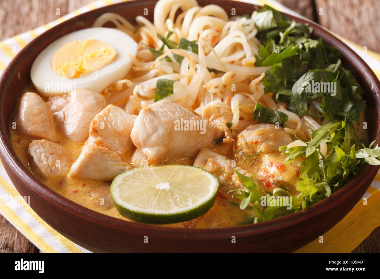 Laksa Soup With Chicken Egg Rice Noodles Bean Sprouts And Coriander In A Bowl Close Up On The Table Horizontal