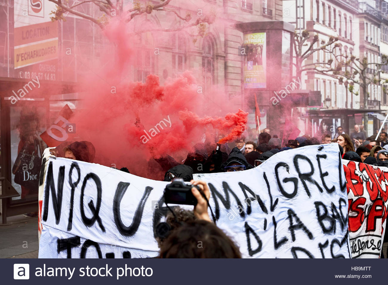 smoke grnades and paint on walls at protest stock photo royalty
