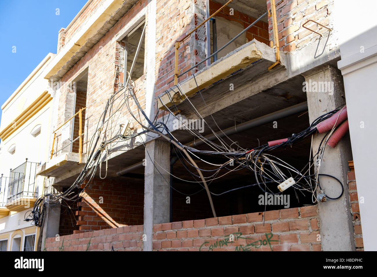 unsafe electrical wiring tangled up outside a house under. Black Bedroom Furniture Sets. Home Design Ideas