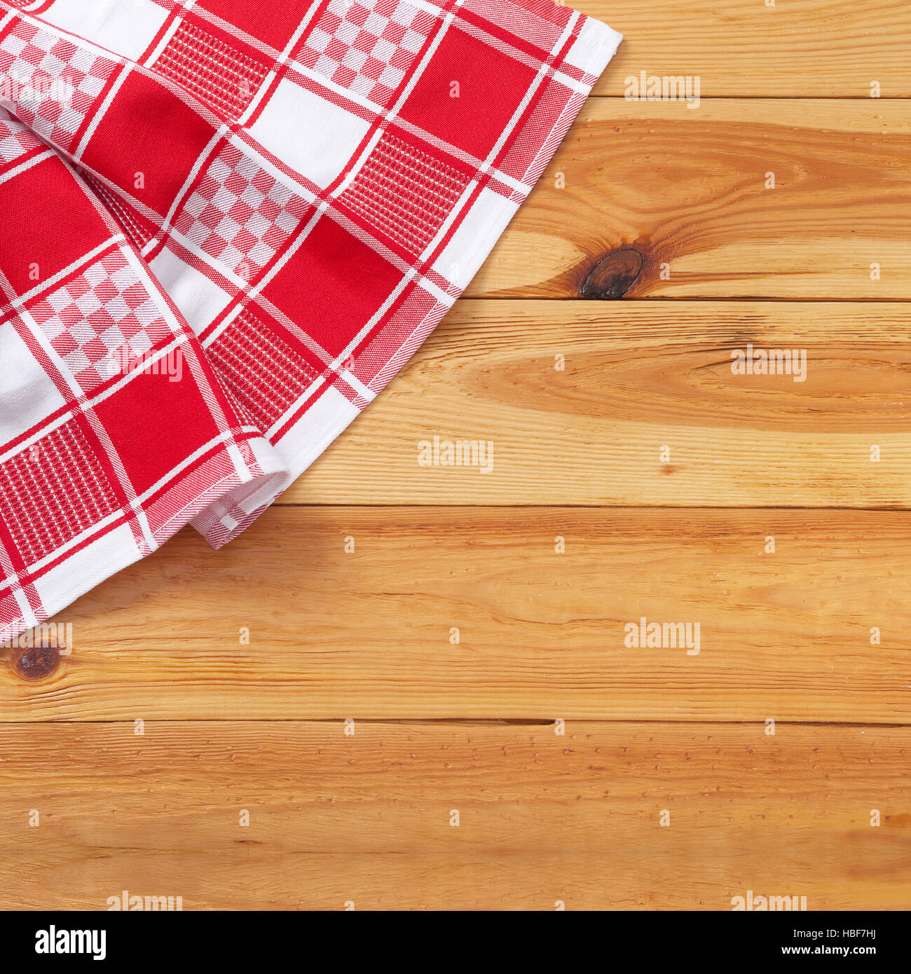 Red Tablecloth Over Wooden Table. Mockup Top View