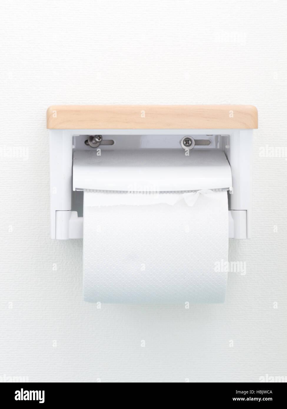 japanese toilet paper holder. Japanese domestic toiletpaper holder on white wall Stock Photo