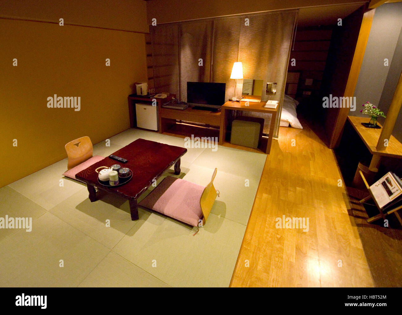 Traditional Japanese style hotel room with tatami mats and futon