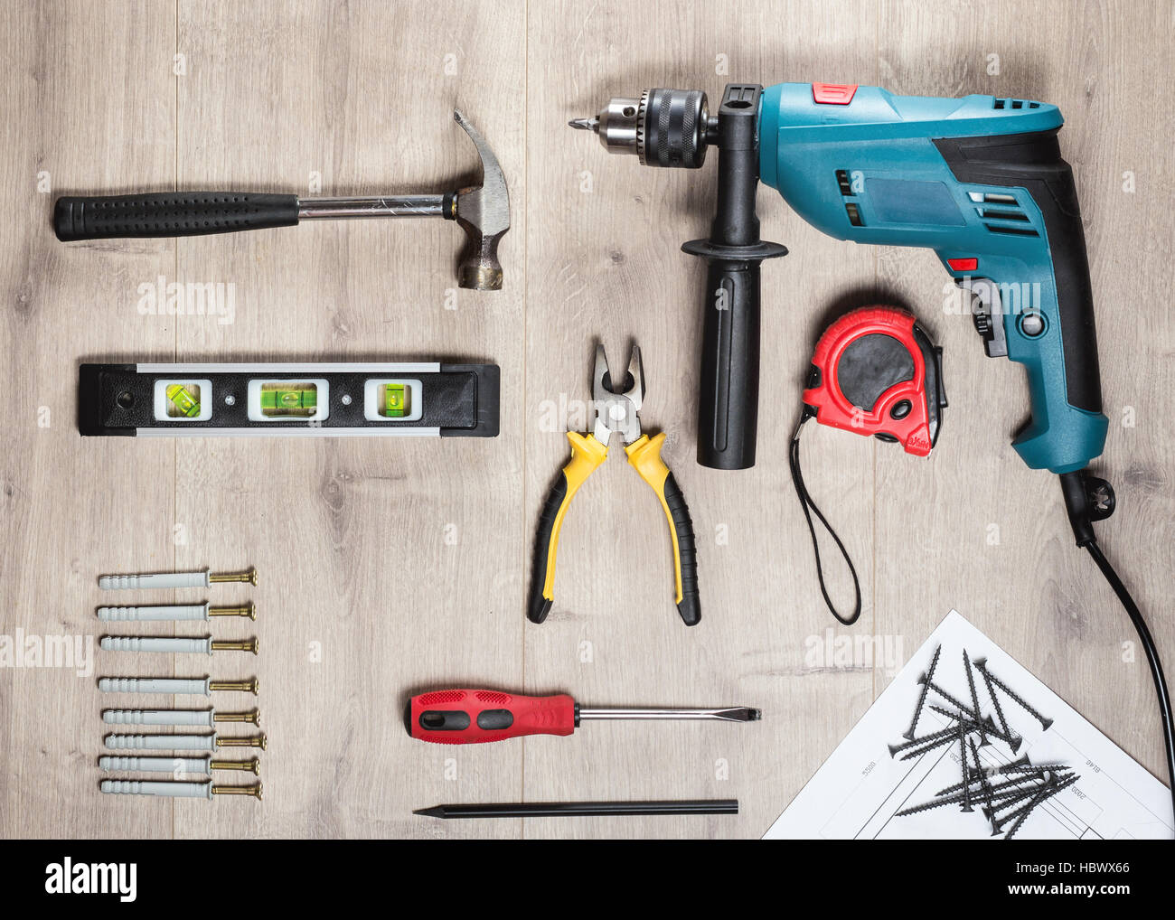 flat lay set of construction tools to repair on a wooden surface