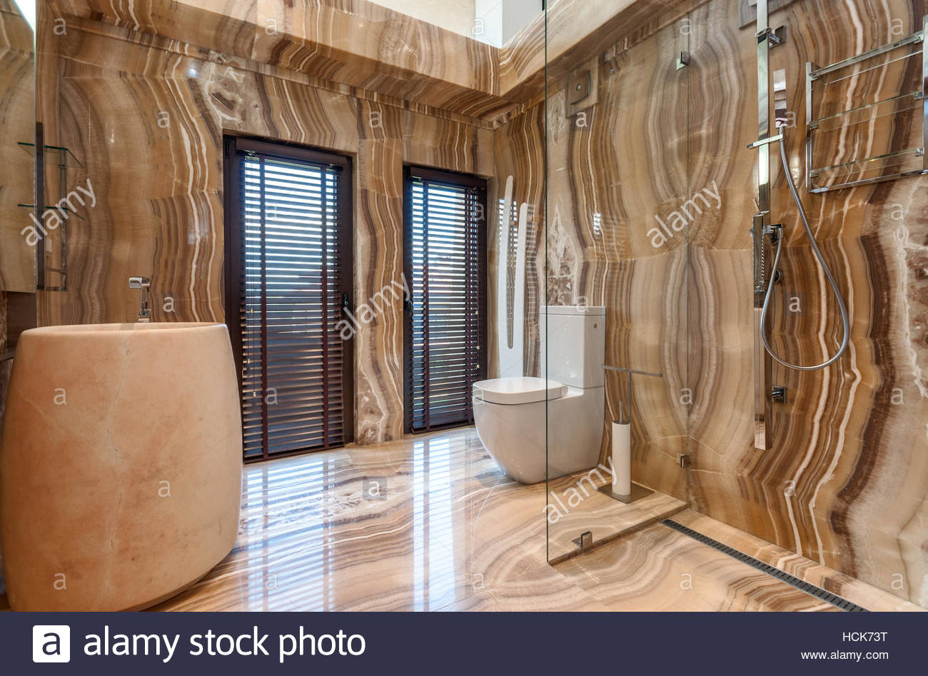 luxurious pink marble bathroom interior in modern contemporary house stock photo royalty free. Black Bedroom Furniture Sets. Home Design Ideas