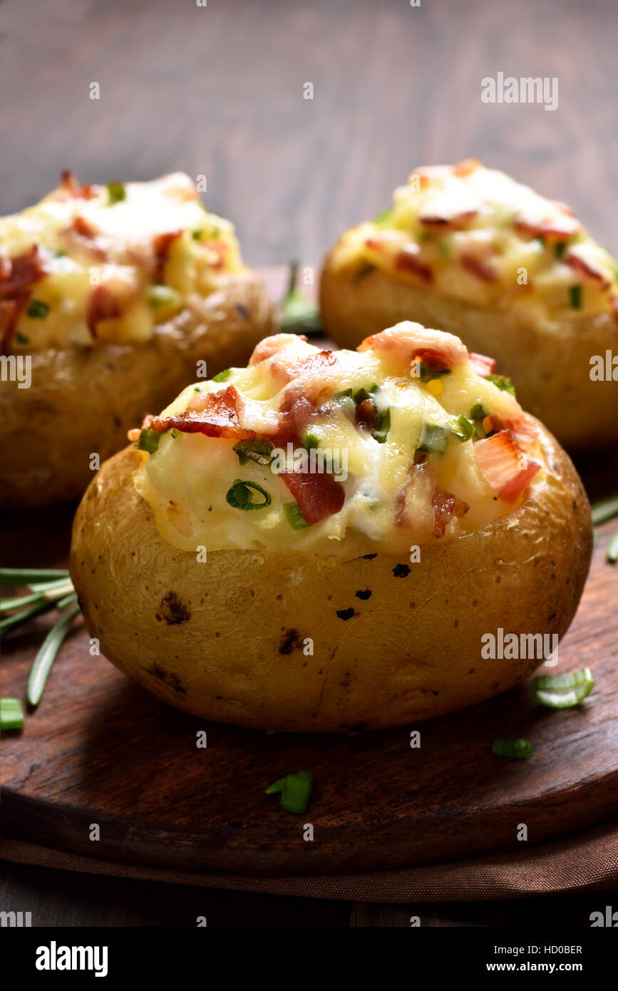 Stuffed potato with bacon, cheese and green onion Stock ...