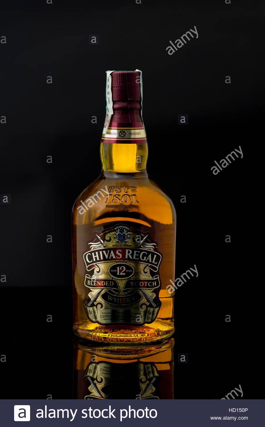 Chivas regal bottle on black background stock photo royalty free chivas regal bottle on black background voltagebd Images