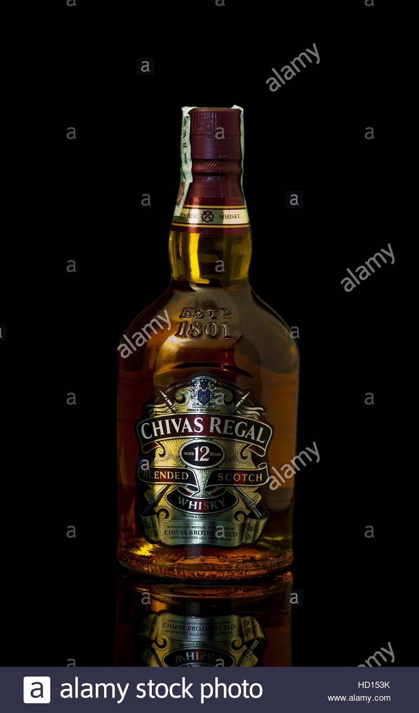 Chivas regal bottle on black background stock photo 128489079 alamy chivas regal bottle on black background voltagebd Images