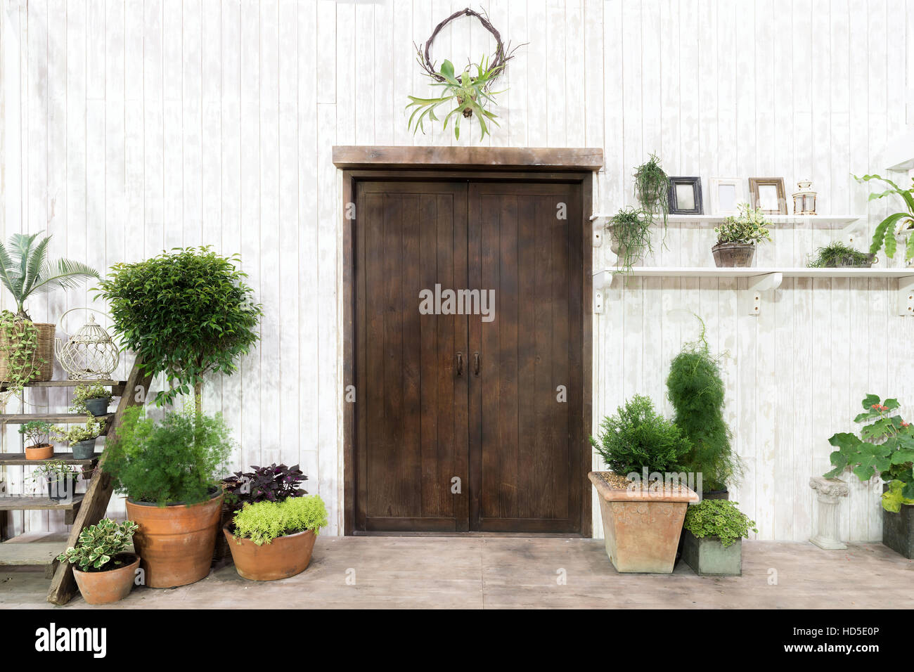 Front Wood Door And Garden Decor In White Cosy House Or Cottage. Exterior  Of House
