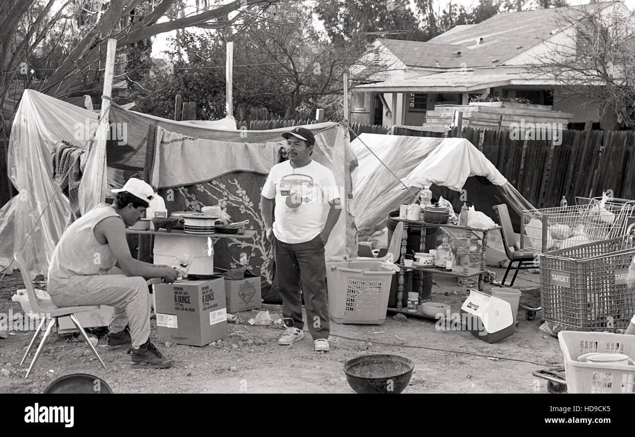 Latinos live in tents and cars outside their destroyed apartment buildings after the 1994 Northridge Earthquake & Latinos live in tents and cars outside their destroyed apartment ...