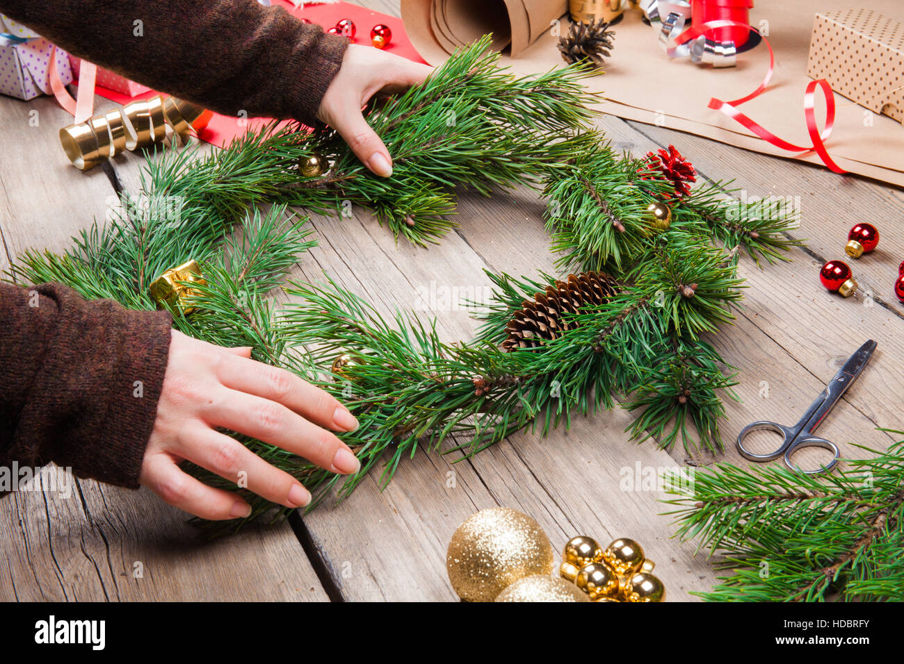Woman making christmas wreath stock photo royalty free Christmas wreaths to make