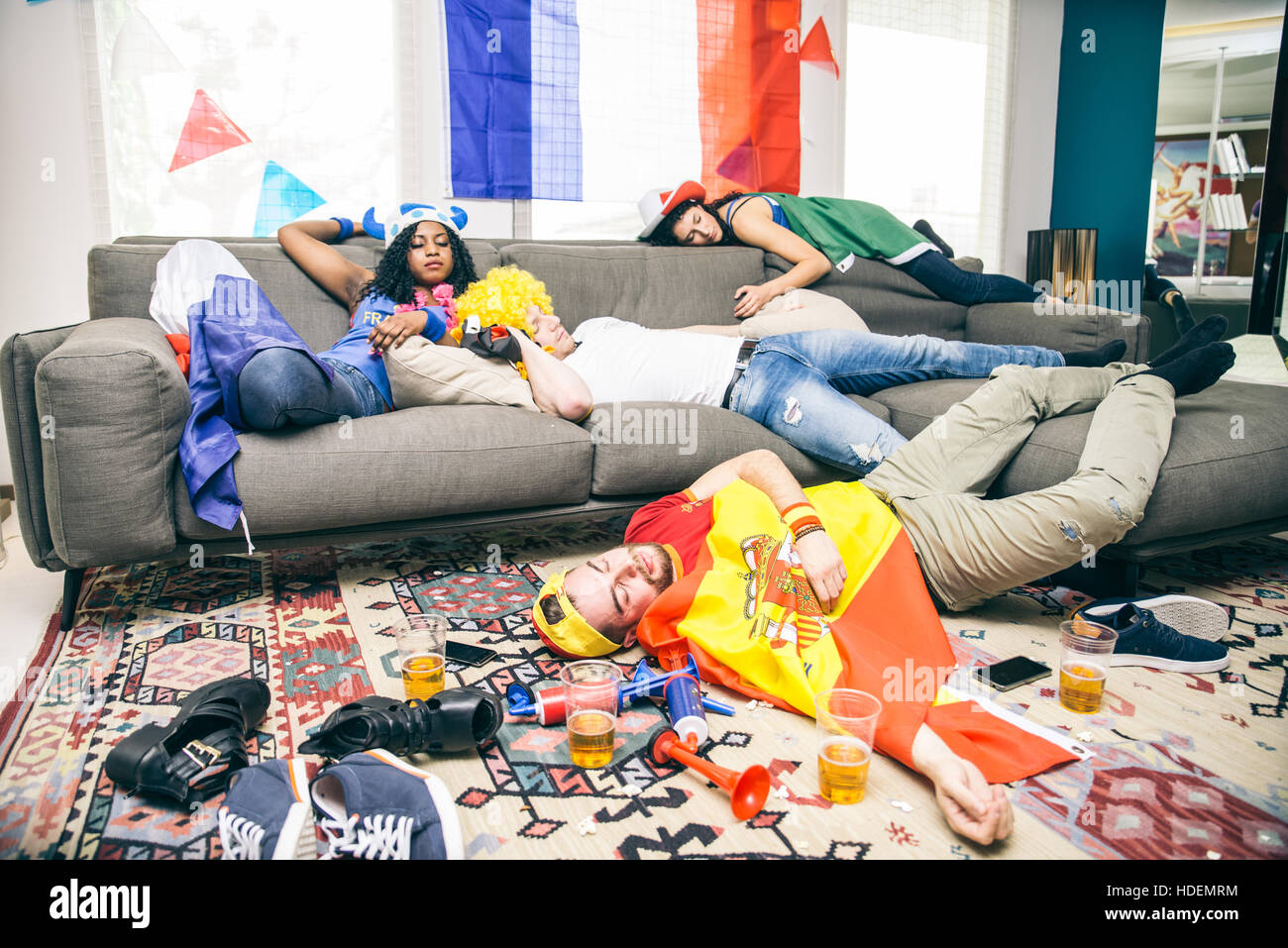 Elegant Group Of Friends Sleeping In A Living Room After Party   Drunk Supporters  Resting After Celebrating Part 25
