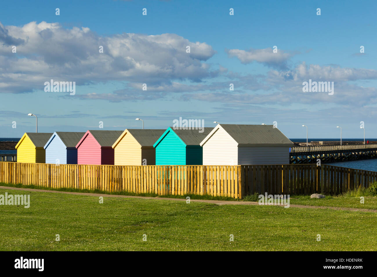 Colourful beach huts on the seafront at amble for Model beach huts
