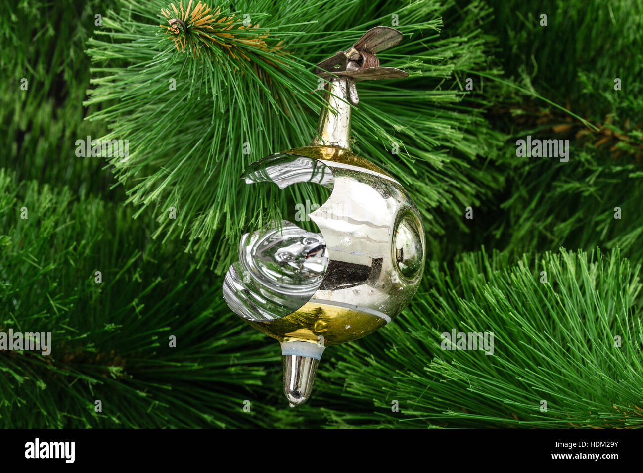 Broken Christmas toy on a Christmas tree background Stock Photo ...