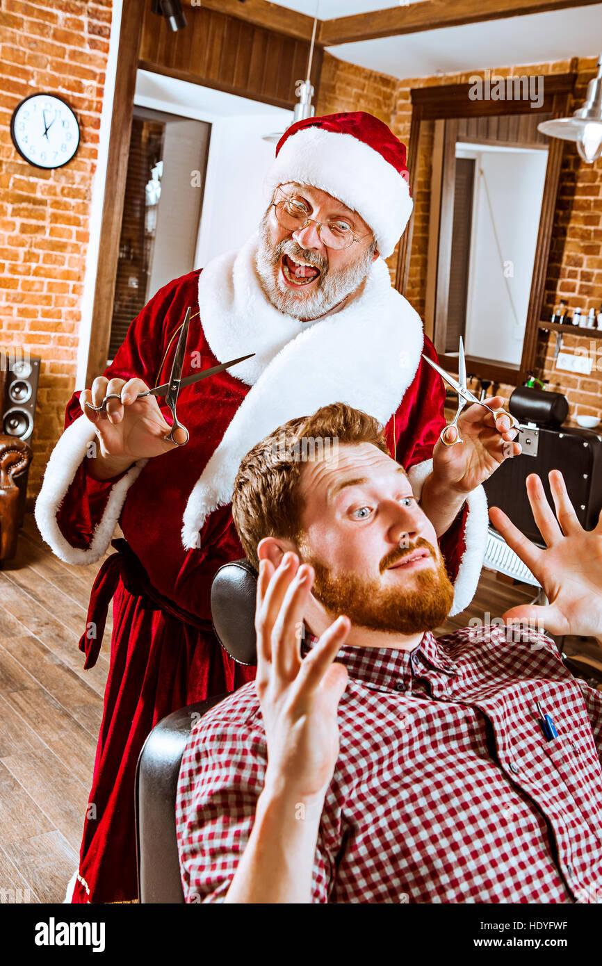 Santa claus as master at barber shop stock photo royalty