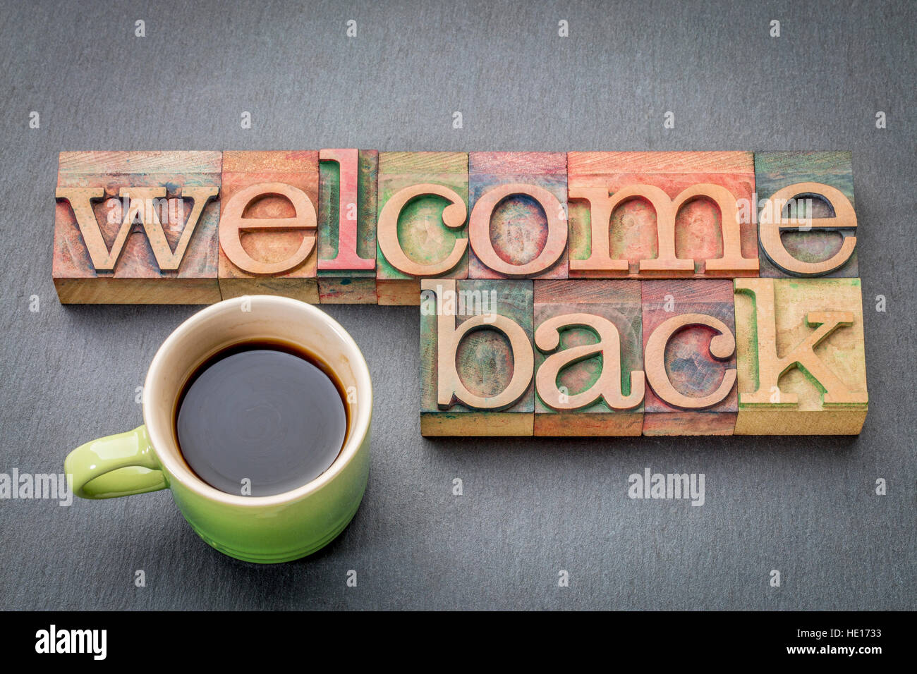 welcome-back-sign-text-in-letterpress-wood-type-with-a-cup-of-coffee-HE1733.jpg