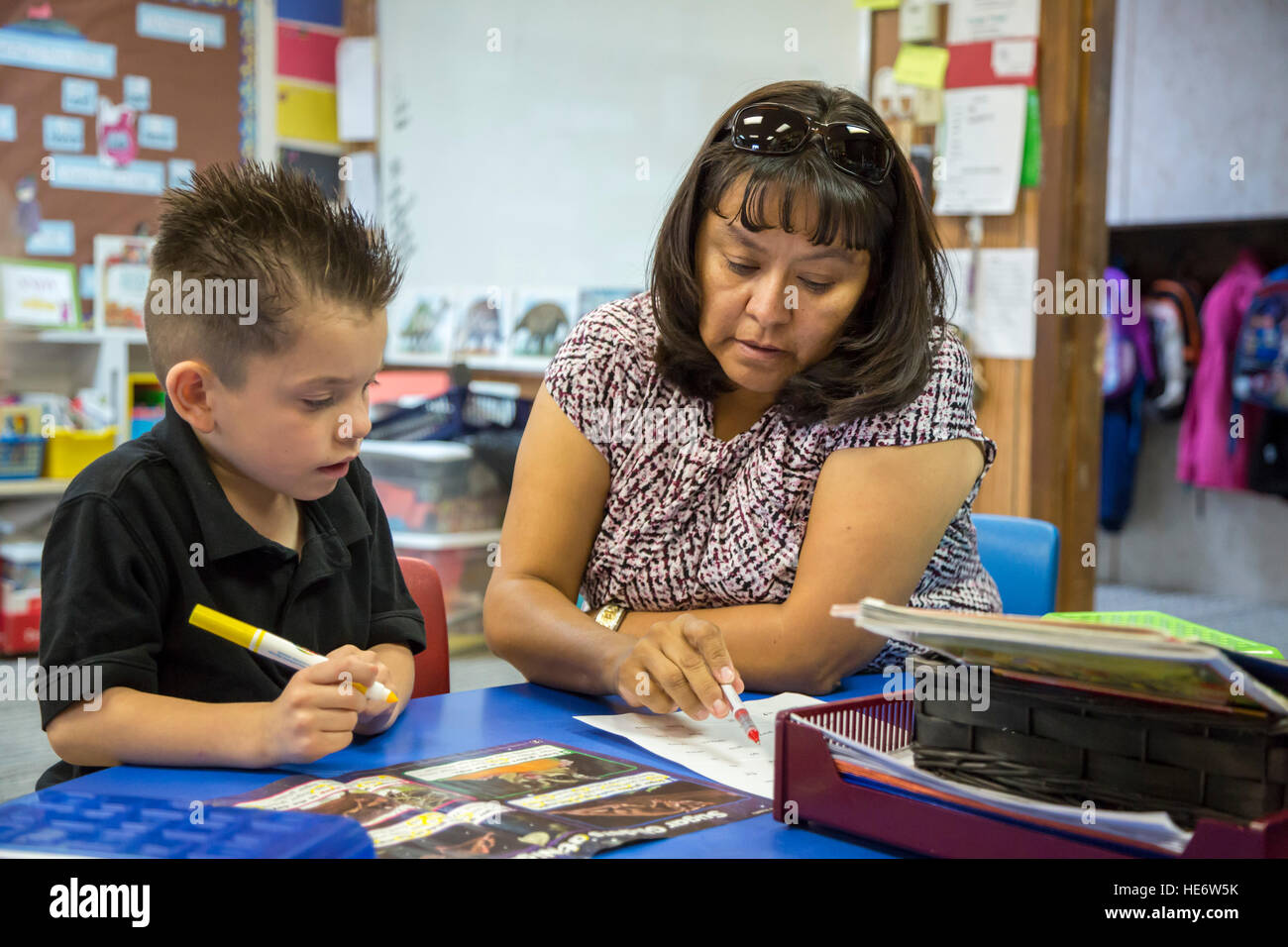Thoreau new mexico classroom assistant jennifer vandever works with a student in a kindergarten