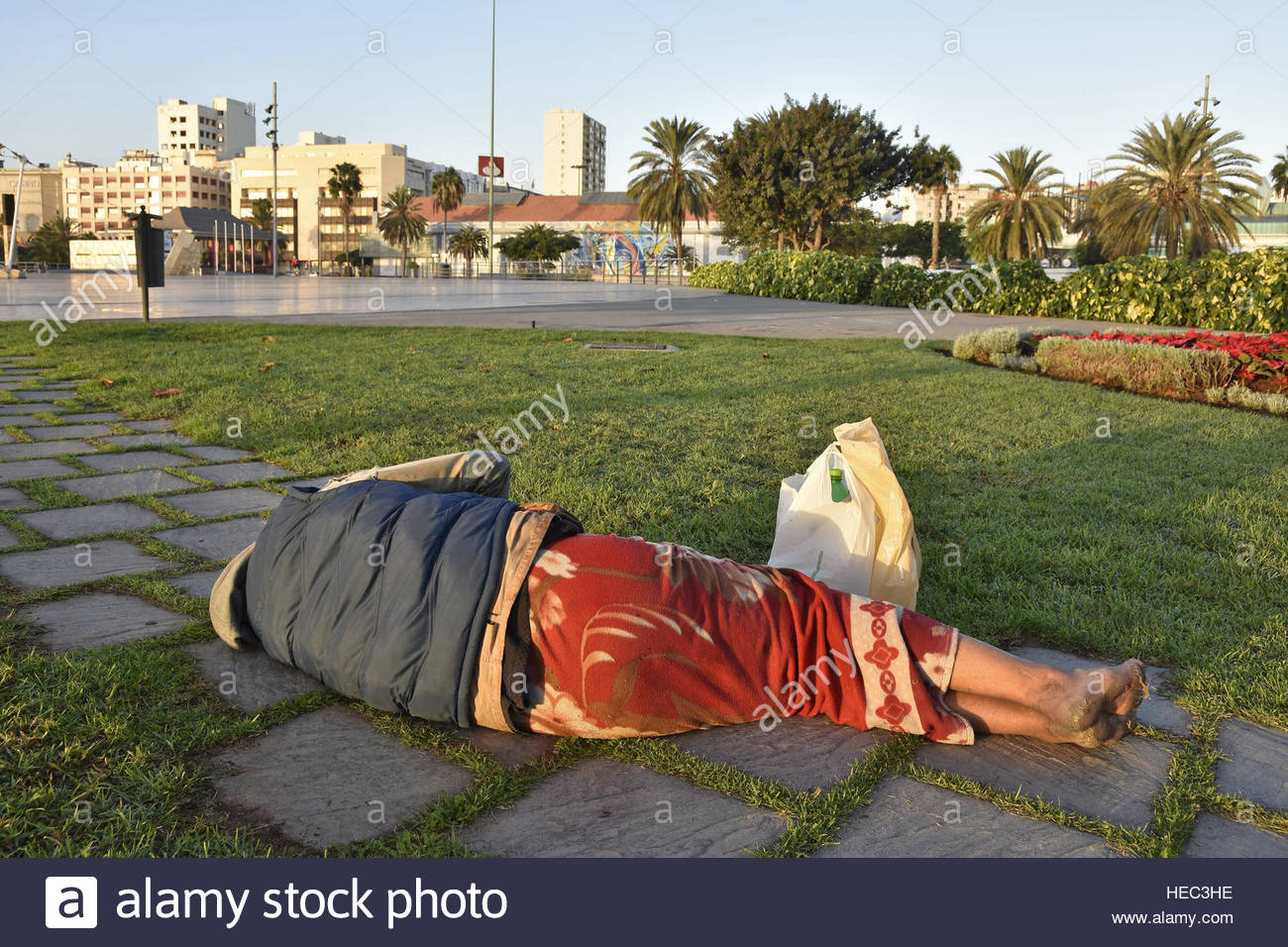 Homeless man sleeping on the ground in las palmas gran - Living in gran canaria ...