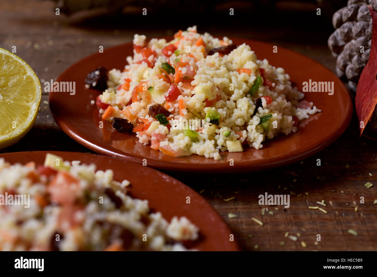 closeup of some earthenware plates with homemade tabbouleh, a