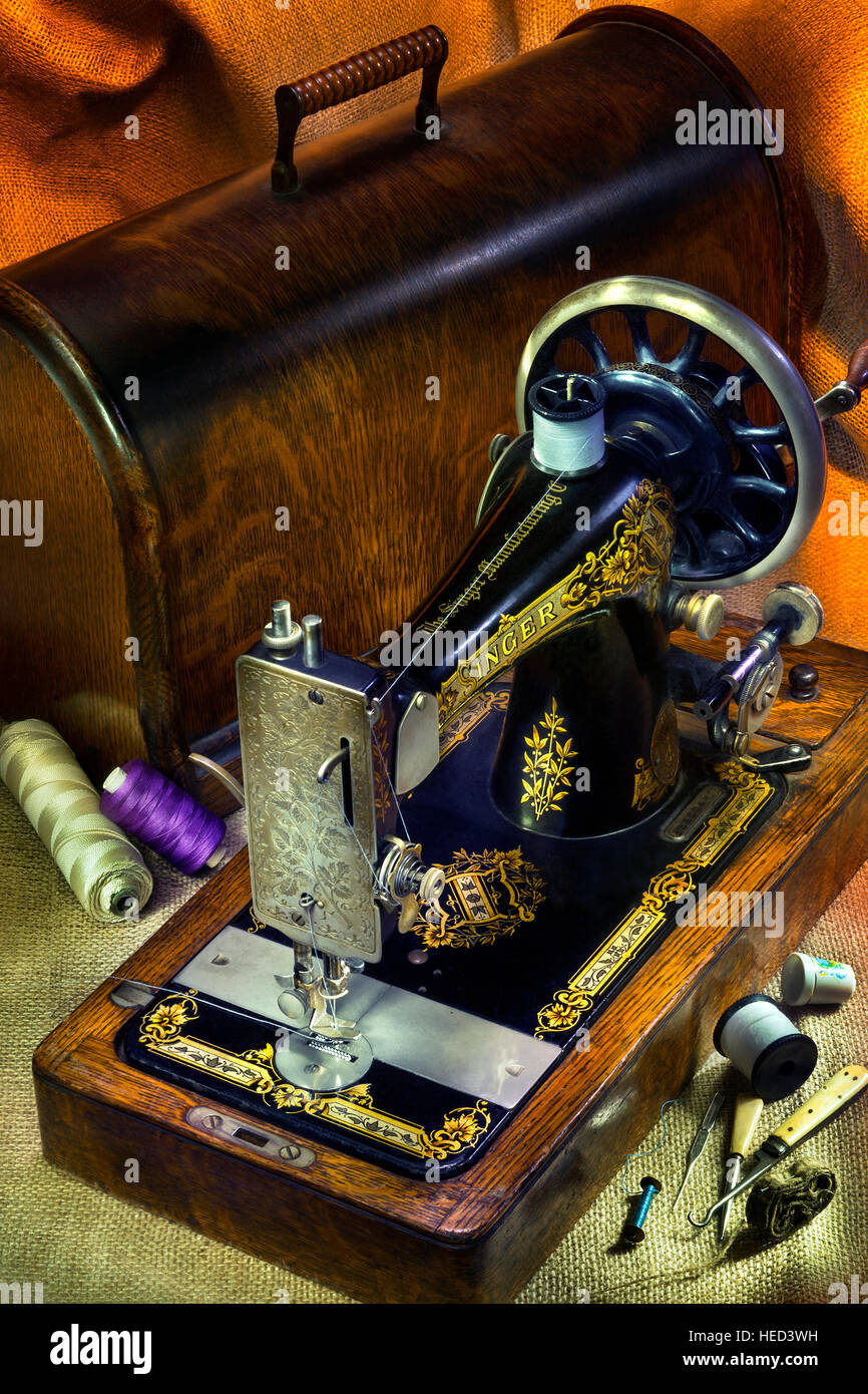 An antique Singer 12 Sewing Machine with gold decoration Stock ...