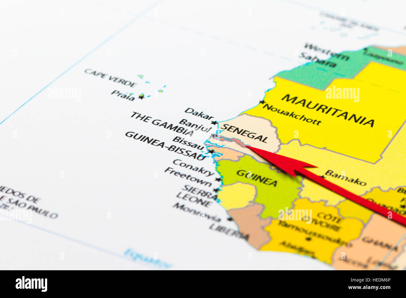 Red arrow pointing The Gambia on the map of Africa continent Stock