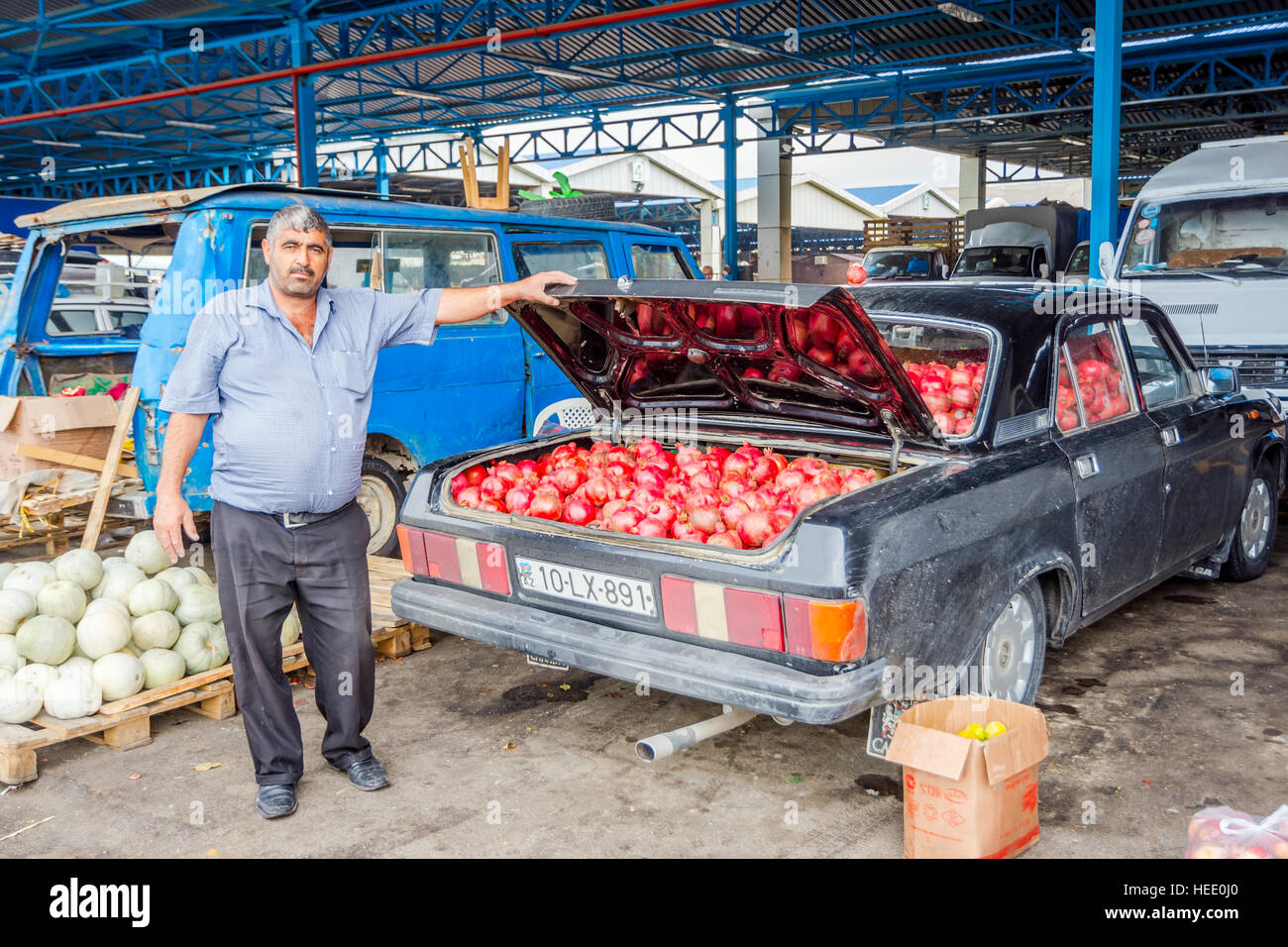 BAKU, AZERBAIJAN - SEPTEMBER 24: Man selling ripe pomegranates from ...