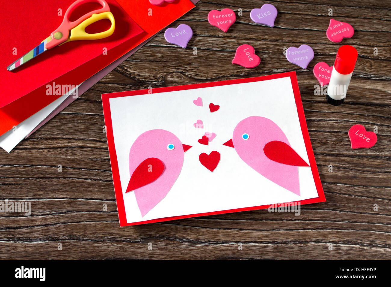Childrens greeting card two birds and heart from a paper on stock childrens greeting card two birds and heart from a paper on valentines day childrens art project a craft for children made by hand kristyandbryce Gallery