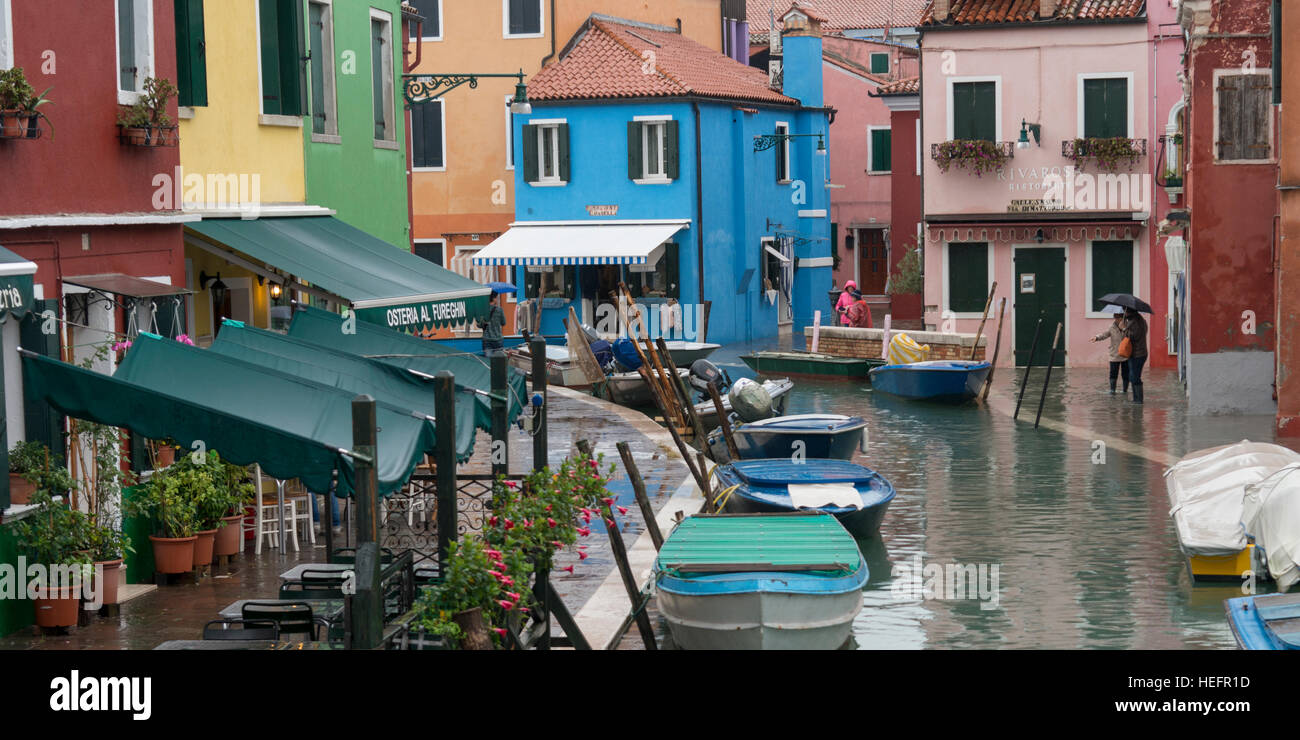 Colorful burano italy burano tourism - Colorful Houses By Canal With Motorboats During Rain Burano Venice Veneto Italy