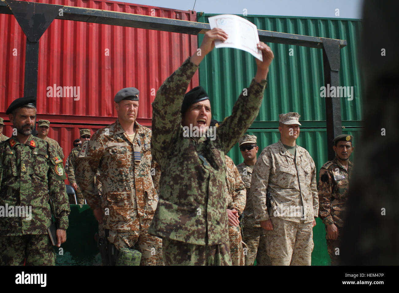 an afghan national army ier holds up his diploma after  an afghan national army ier holds up his diploma after graduating from a course at the regional military training center at camp shorabak