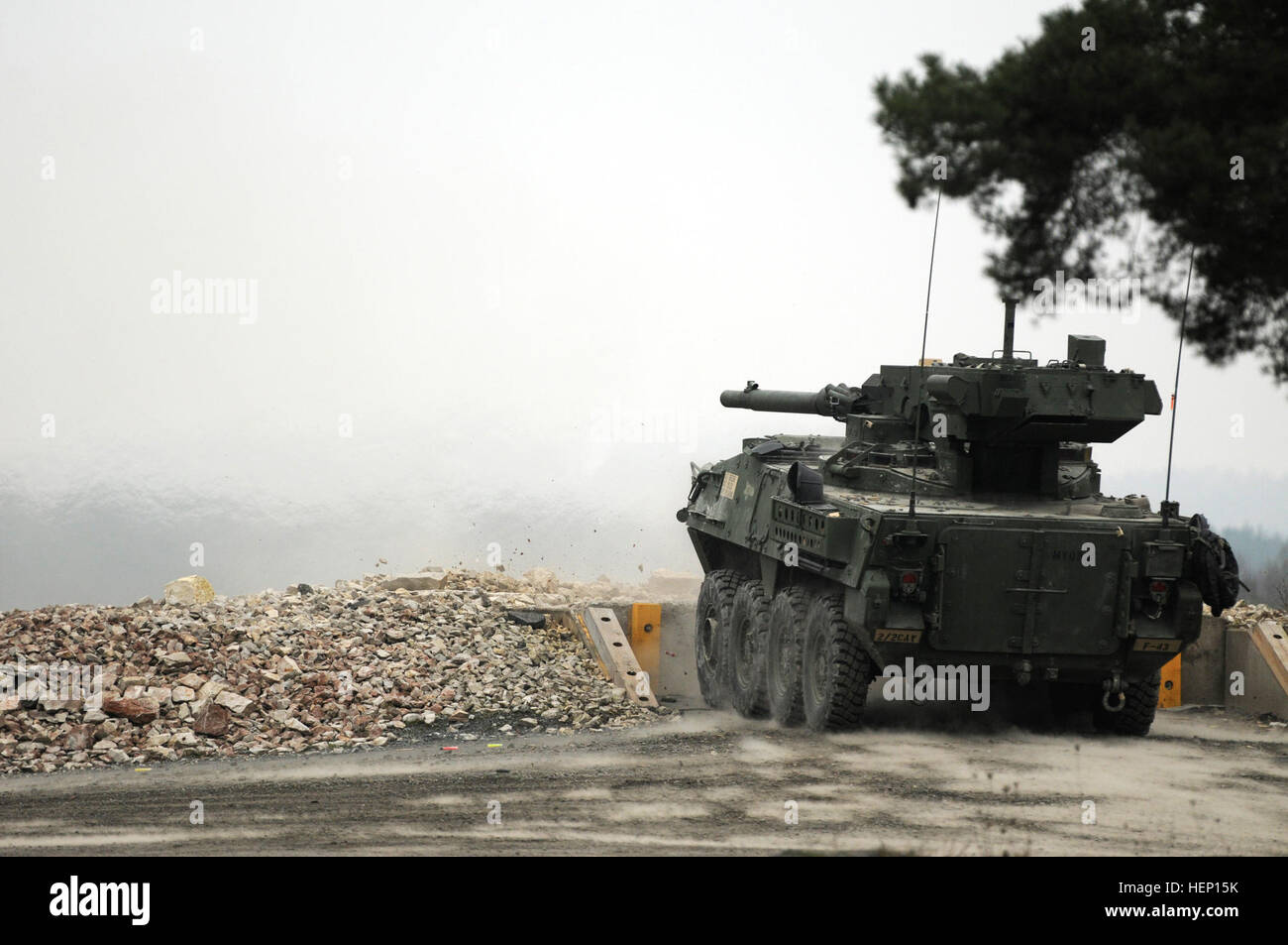 A m1128 stryker mobile gun system assigned to unit fires a 105mm round downrage
