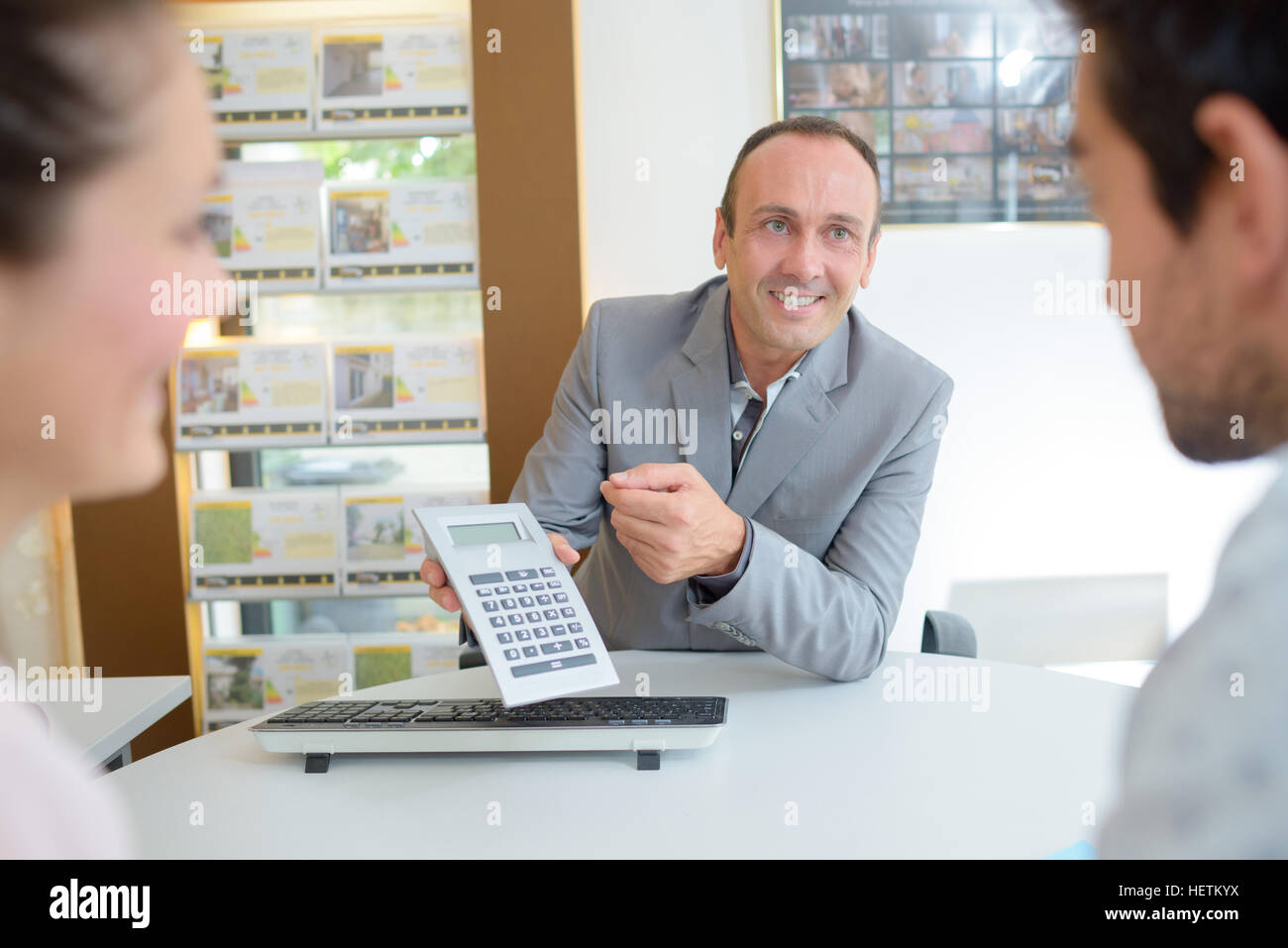 couple negotiating offer in estate agents stock photo royalty stock photo couple negotiating offer in estate agents