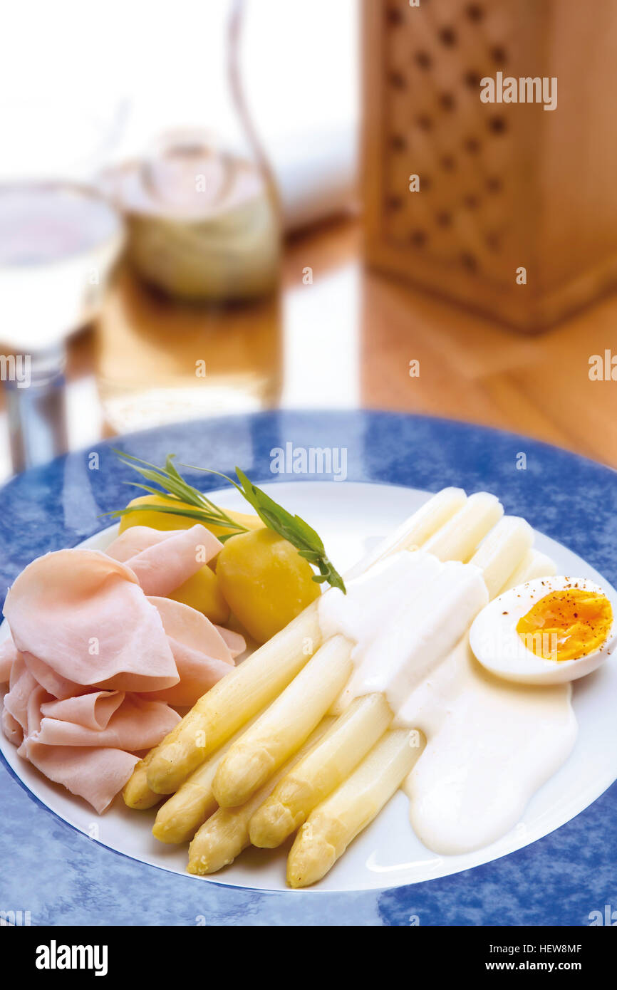 Stock Photo White Asparagus, Hollandaise Sauce, Boiled Egg, Slices Of Cooked  Ham And