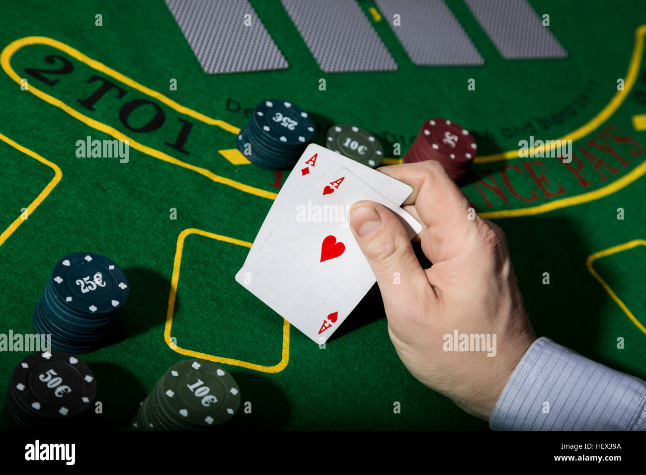 Poker table background - Stock Photo Poker Playing Card On A Green Table Background Man Holding Two Aces