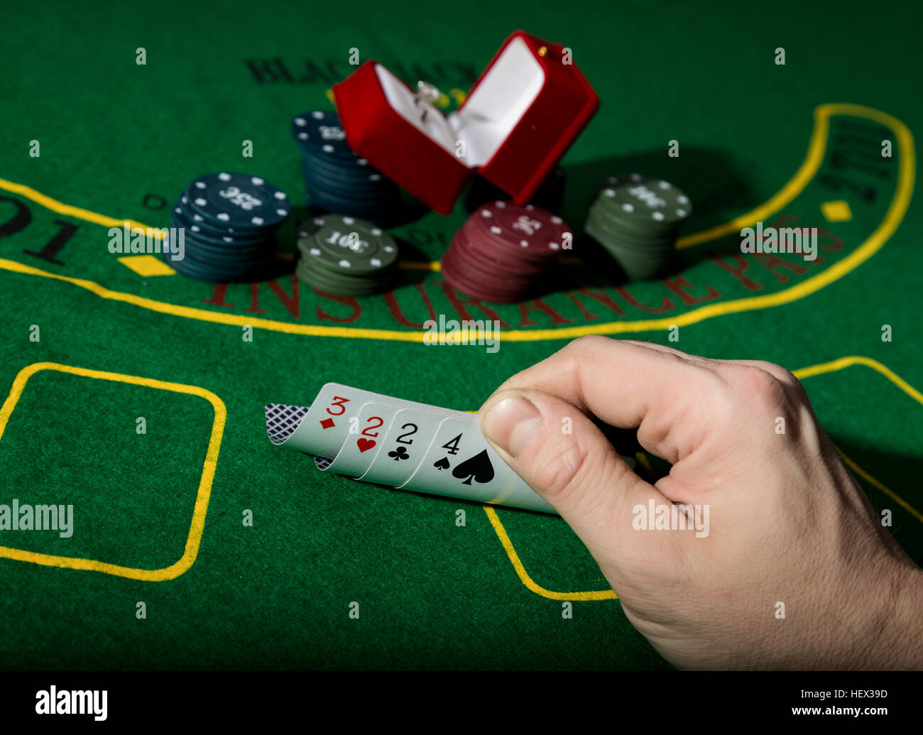 Poker table background - Stock Photo Casino Chips And A Precious Ring On Green Poker Table Background Man Holding Losing Combination Of Cards