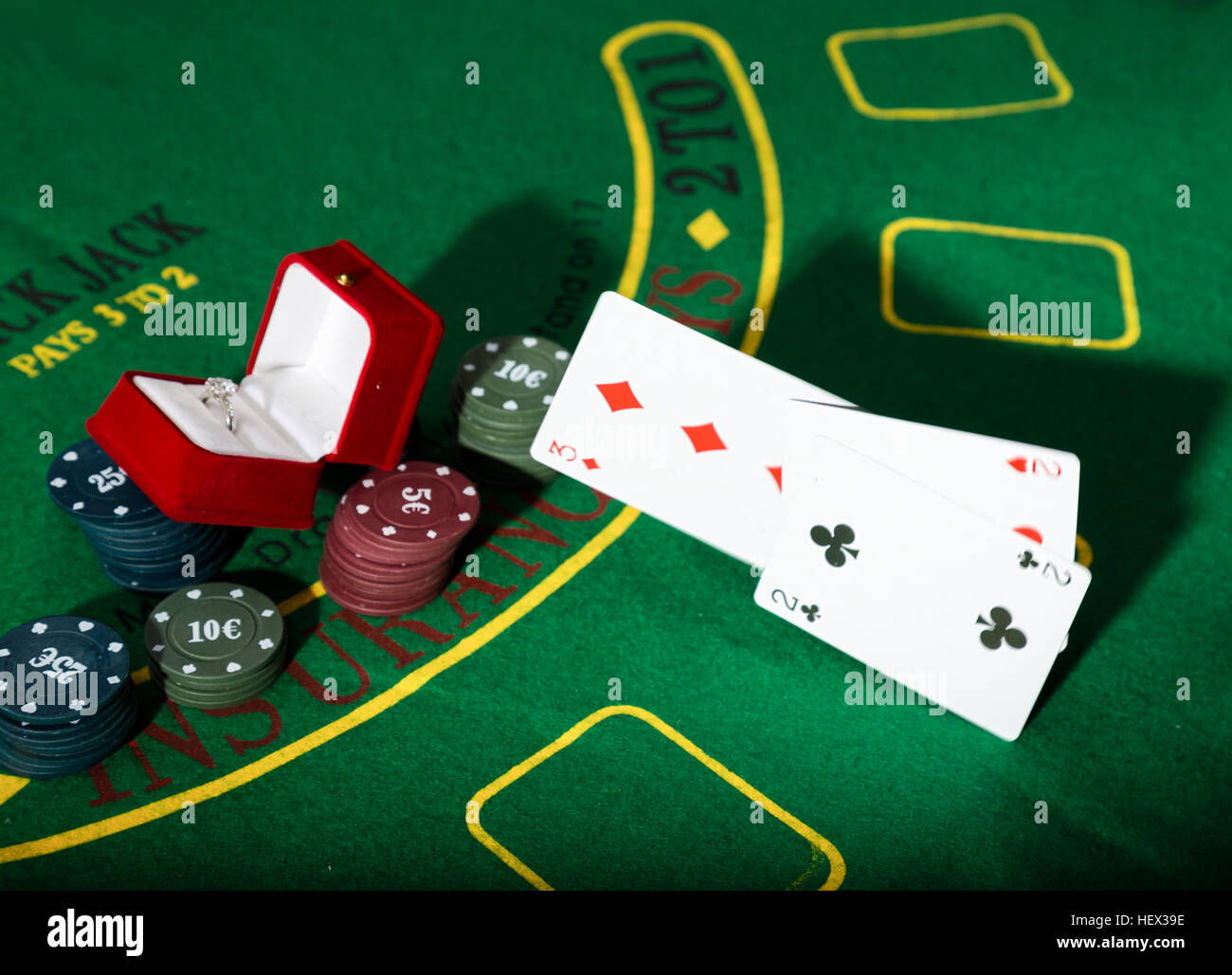 Poker table background - Stock Photo Casino Chips And A Precious Ring On Green Poker Table Background Man Throws Cards With Losing Combination