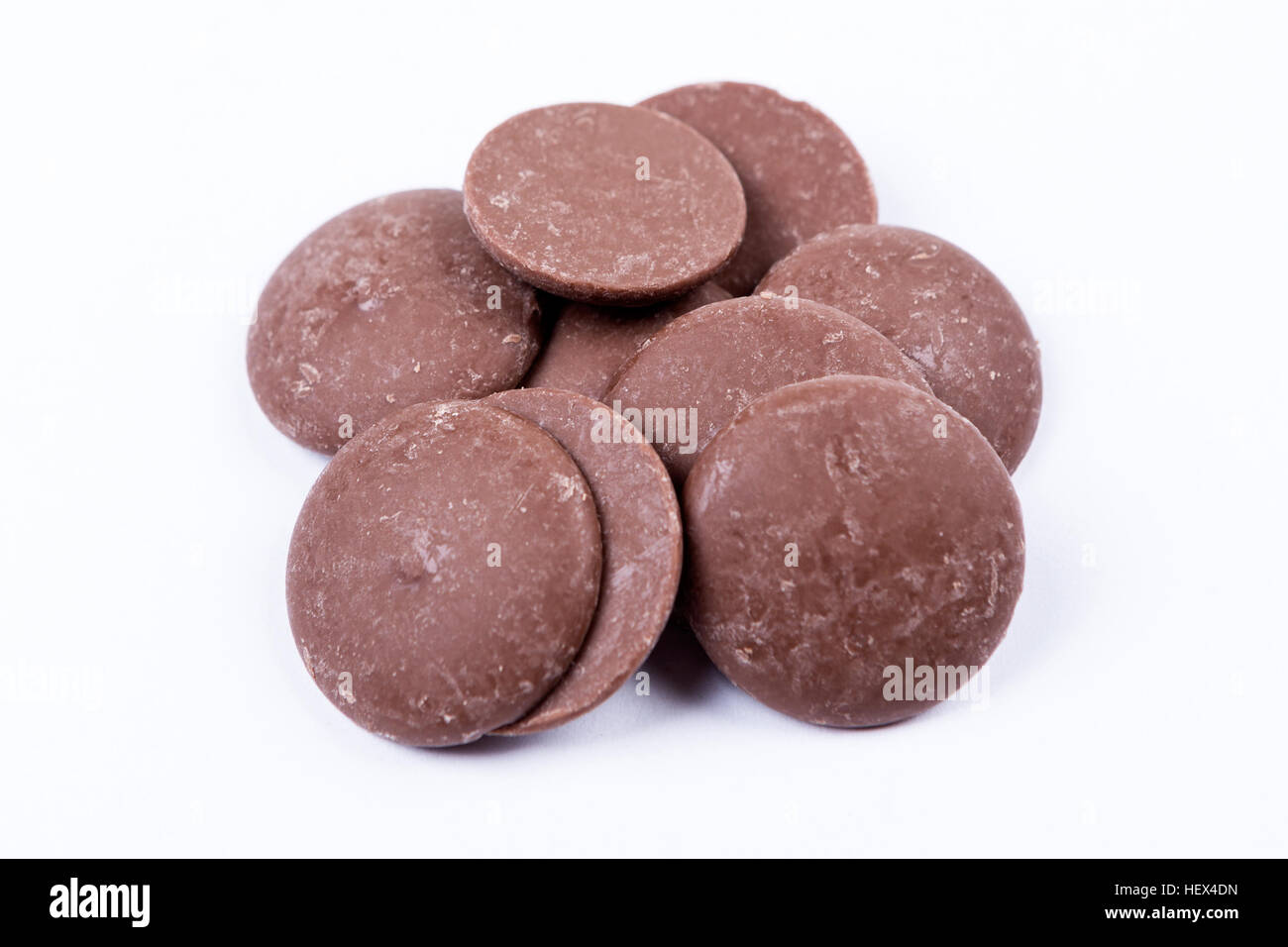 Milk chocolate melts isolated on white background Stock Photo ...
